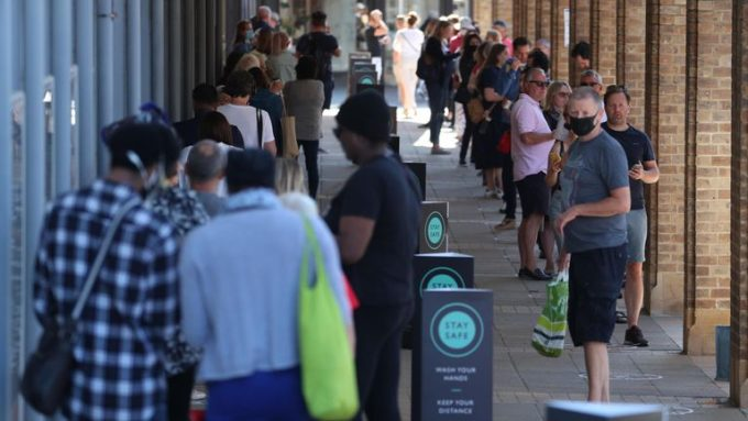 Queues as non-essential retail reopened in England. Credit: Sky News